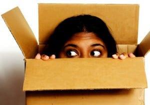 Woman peeking out of the box