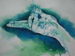 Painted hand in mudra