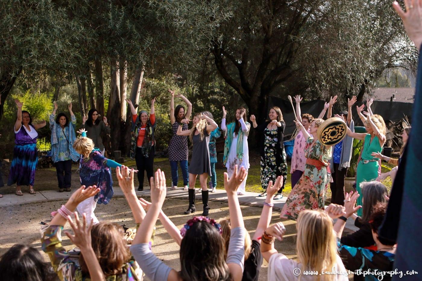 hands up women fire circle