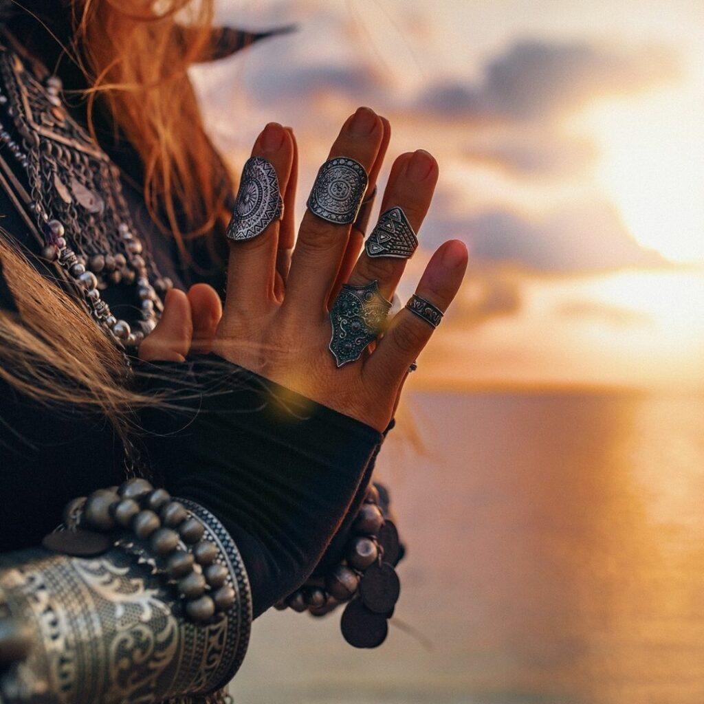 IG Priestess hands in prayer sunrise